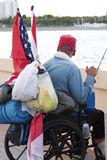 Homeless Vet 2. Homeless veteran in a wheelchair looking out at the ocean stock photo