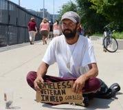Homeless veteran begs for money straight on Royalty Free Stock Image