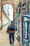 Homeless walking along Manhattan Bridge, New York City Stock Image