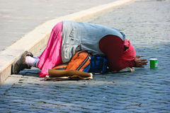 Homeless woman. Begging on the street Stock Photo