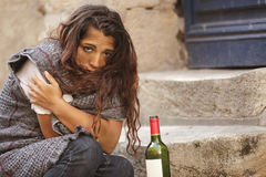 Homeless woman. Poor homeless drunk woman in cold weather Stock Images
