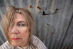 Homeless Woman. Senior homeless woman with too much makeup Stock Photography