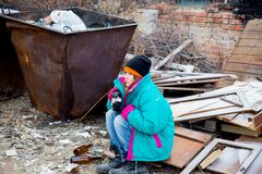 Homeless woman. A portrait of a homeless hungry woman royalty free stock photo