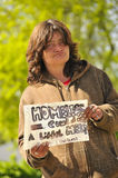 Homeless Woman Needing Help. Holding a Sign Stock Photo