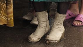Torn boots on a homeless woman. Homeless woman in old shoes at the street stock footage