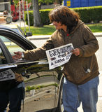 Homeless Woman Receiving Help. From Strangers Royalty Free Stock Photos