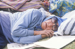 Homeless woman sleeping in a park, Los Angeles, California Royalty Free Stock Photo