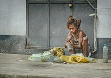 A homeless woman on the street Stock Images