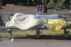 Homeless women sleeping on bench, Washington D.C. Stock Images