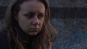 Homeless young woman in abandoned lane suffering from drug addiction, poverty. Stock footage stock footage
