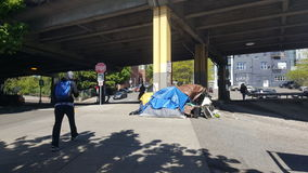 Homelessness in Seattle. A small structure/ tent built under an overpass in Seattle Washington Royalty Free Stock Photography