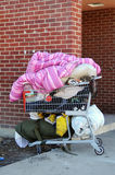 Homelessness. A shopping cart filled with a homeless persons belongings Stock Photography