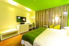 Homelike hotel bedroom Stock Photo