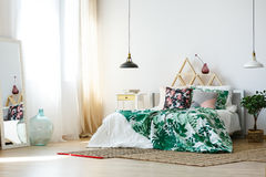 Homely bedroom with colorful accessories. Homely restful bedroom with colorful accessories and soft sheets stock photos