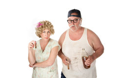 Homely couple. With cigars and beer on white background stock photos