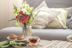 Homely cozy spring interior in the living room stock photo