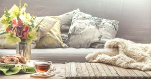 Homely cozy spring interior in the living room stock photography