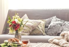 Homely cozy spring interior in the living room. With a vase and flowers homemade breakfast, home comfort concept royalty free stock photos