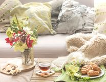 Homely cozy spring interior in the living room stock images