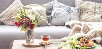 Homely cozy spring interior in the living room royalty free stock photography
