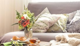 Homely cozy spring interior in the living room royalty free stock photos