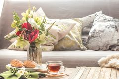 Homely cozy spring interior in the living room stock image