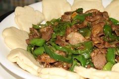 Homely fried pork slices Stock Photo