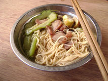 Homely noodle lunch. With bitter gourd and pork stock photography