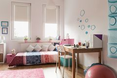 Homely teen room. With rose and blue decorations royalty free stock image
