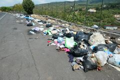 Homely trash thrown on the streets in Sicily.