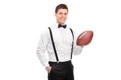 Homem à moda que guarda um futebol Fotografia de Stock