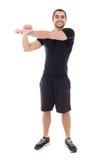 Homem árabe farpado considerável nas mãos de aquecimento do sportswear antes de t fotos de stock royalty free