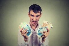 Homem ávido com euro- cédulas Imagem de Stock Royalty Free