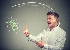 Homem ávido que deseja para a nota de dólar imagem de stock royalty free