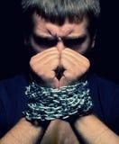 Homem acorrentado Imagens de Stock