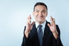 Homem adulto agradável que mostra uma careta imagens de stock royalty free