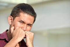 Homem adulto filipino novo receoso imagens de stock royalty free