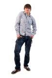 Homem adulto novo das calças de brim modernas. imagens de stock royalty free
