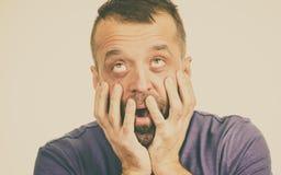 Homem adulto Scared fotografia de stock
