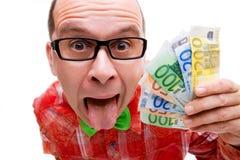 Homem afortunado com punhado do dinheiro Fotos de Stock
