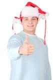 Homem alegre de Santa com polegares acima Fotografia de Stock Royalty Free