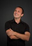 Homem amigável no preto Fotografia de Stock Royalty Free
