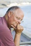 Homem aposentado interessado Imagens de Stock