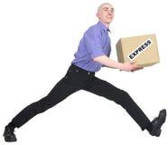 Homem a apressar-se para entregar a caixa foto de stock royalty free