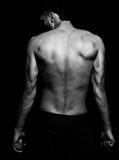 Homem apto da carne sem gordura com parte traseira muscular fotos de stock