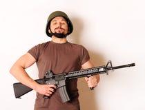 Homem armado Imagens de Stock