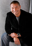 Homem asiático de sorriso Fotografia de Stock Royalty Free