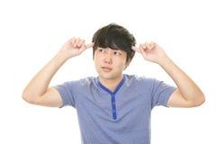 Homem asiático inquieto fotografia de stock royalty free