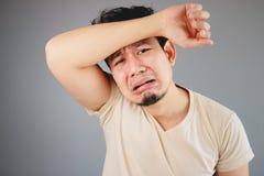 Homem asiático triste Imagem de Stock