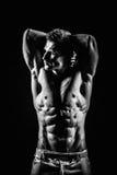 Homem atlético considerável muito muscular imagem de stock
